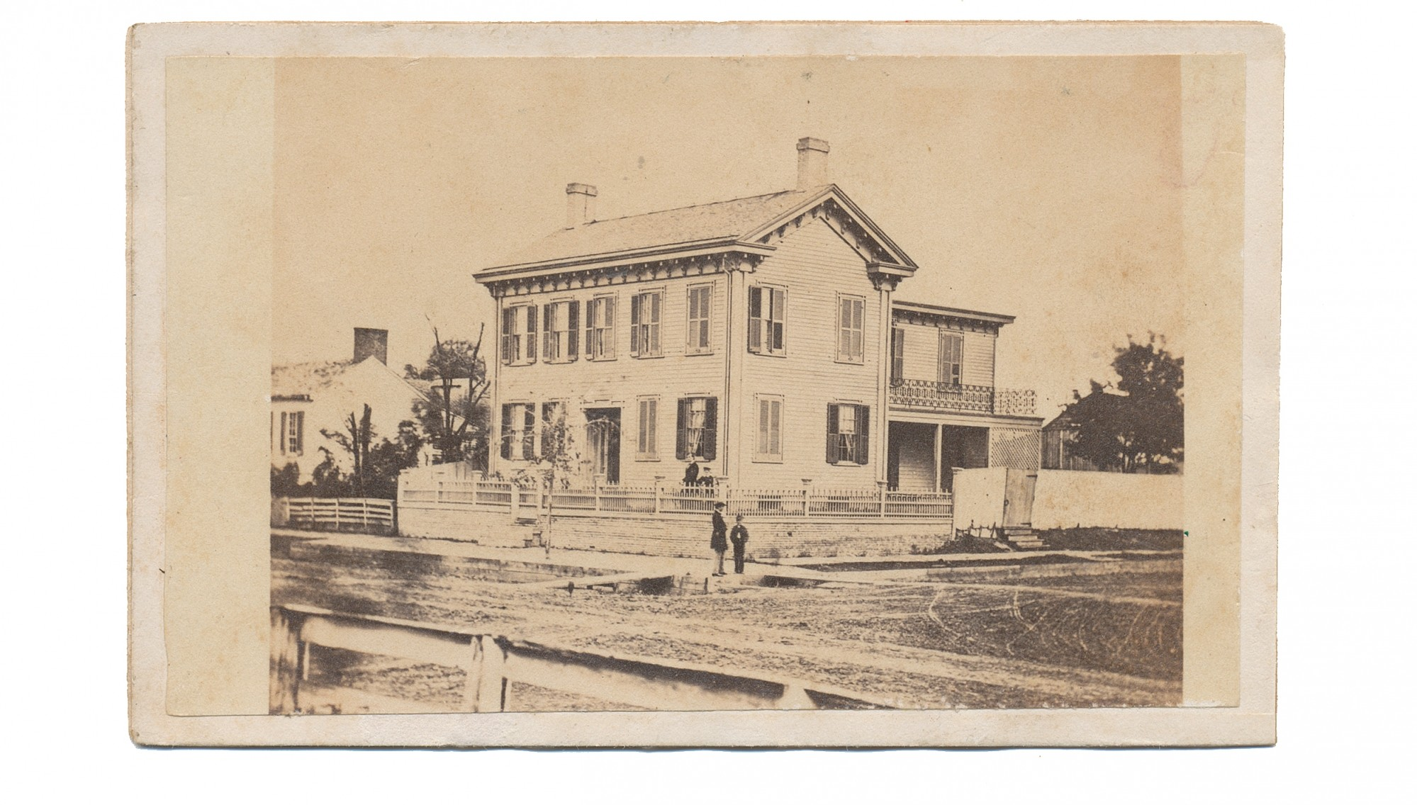 CDV VIEW OF THE LINCOLN HOME IN SPRINGFIELD WITH ABE & SON IN THE FRONT YARD