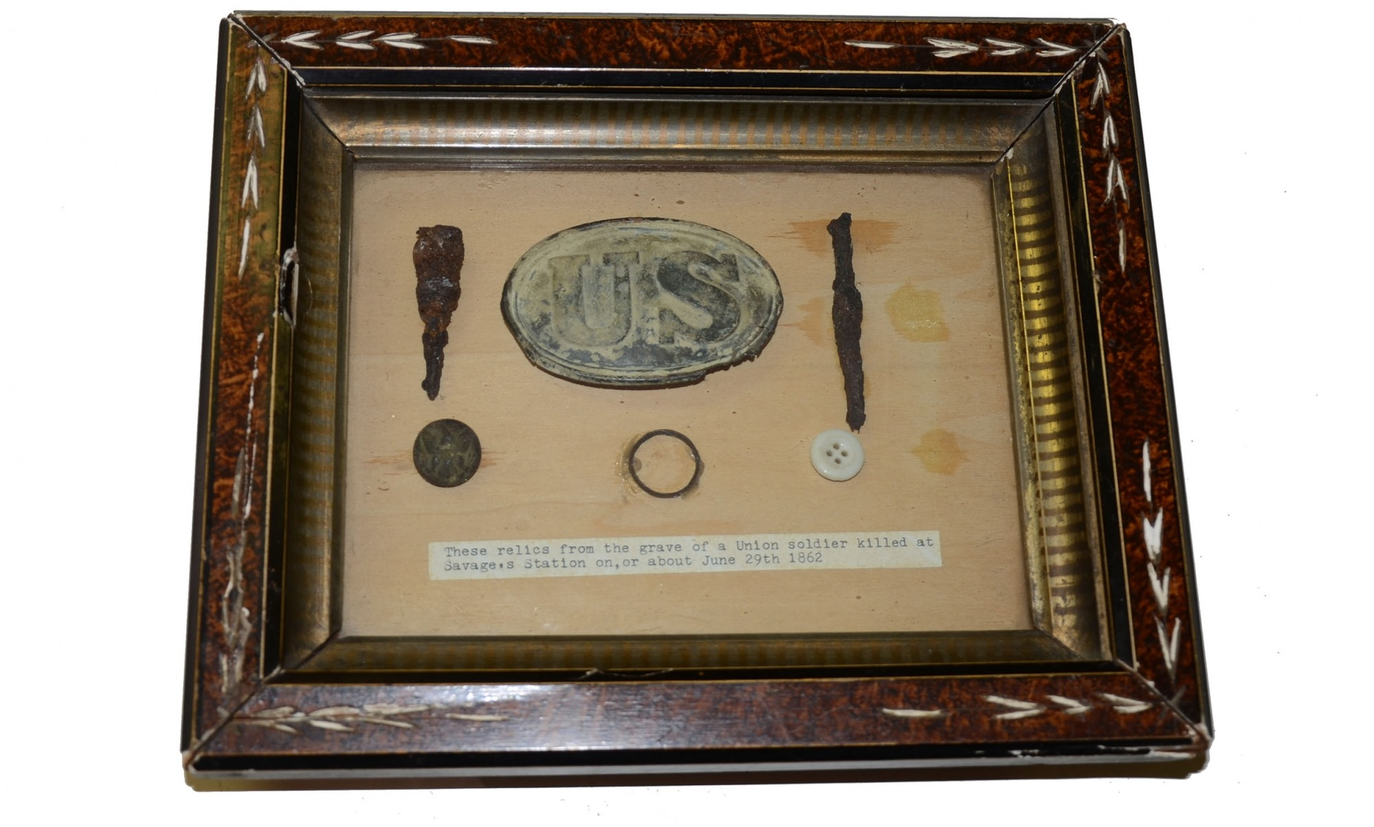 SHADOW BOX OF ITEMS RECOVERED FROM GRAVE AT SAVAGE'S STATION