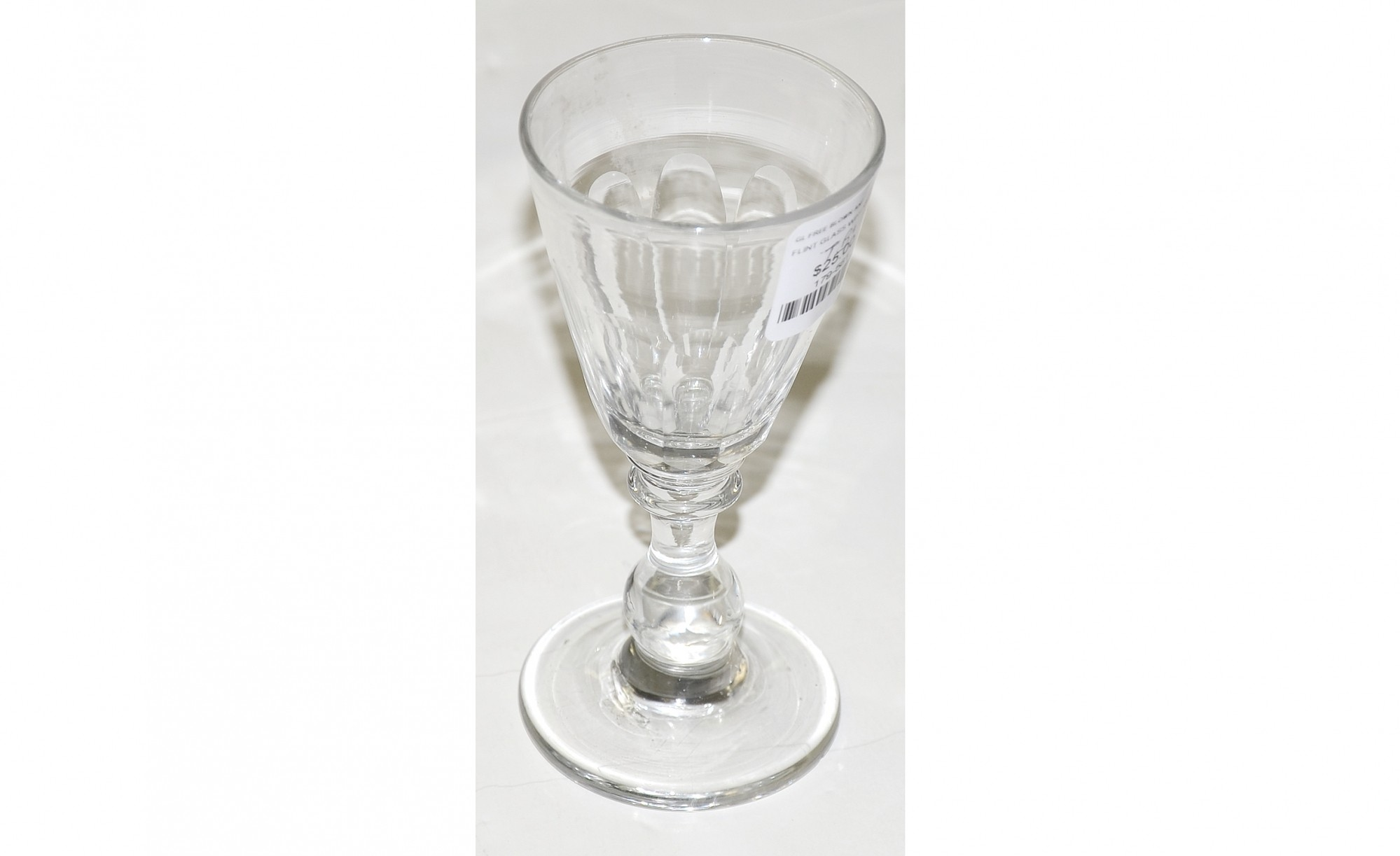 EARLY 19TH CENTURY FREE BLOWN AND CUT PANEL WINE GLASS