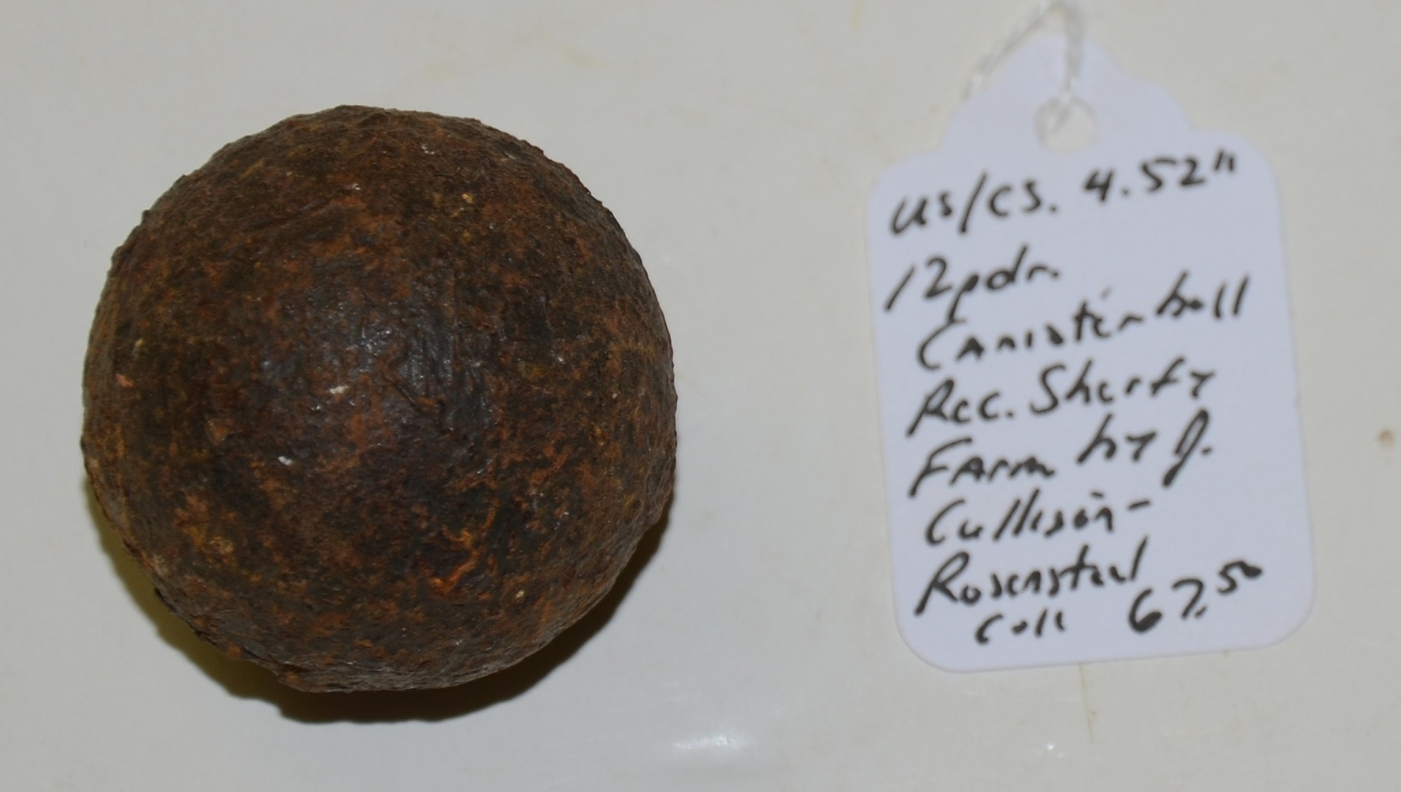"US/CS 4.52"" 12 PDR. CANISTER BALL RECOVERED ON THE SHERFY FARM, GETTYSBURG"