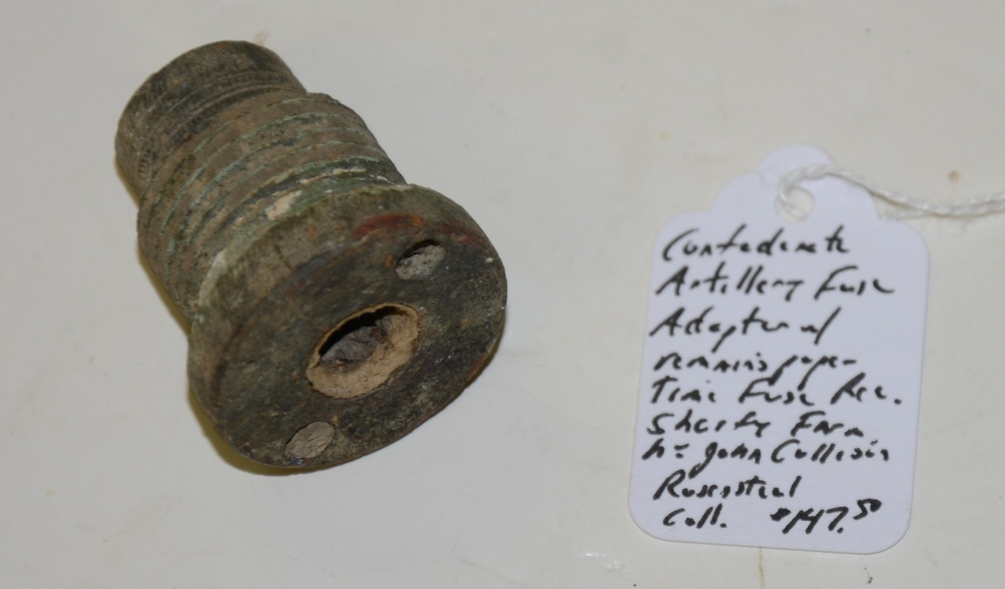 CONFEDERATE ARTILLERY FUSE ADAPTER WITH REMAINS OF PAPER TIME FUSE RECOVERED ON THE SHERFY FARM, GETTYSBURG