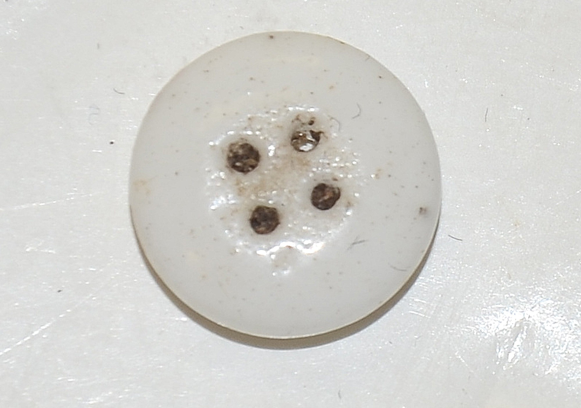 US/CS PORCELAIN SHIRT BUTTON, RECOVERED FROM KLINGEL FARM, GETTYSBURG