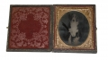 SIXTH PLATE AMBROTYPE OF BLACK AND WHITE DOG