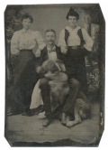 1/8 PLATE TINTYPE OF THREE PEOPLE WITH A LARGE DOG