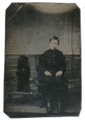 TINTYPE OF BOY WITH DOG STANDING ON ITS HIND LEGS