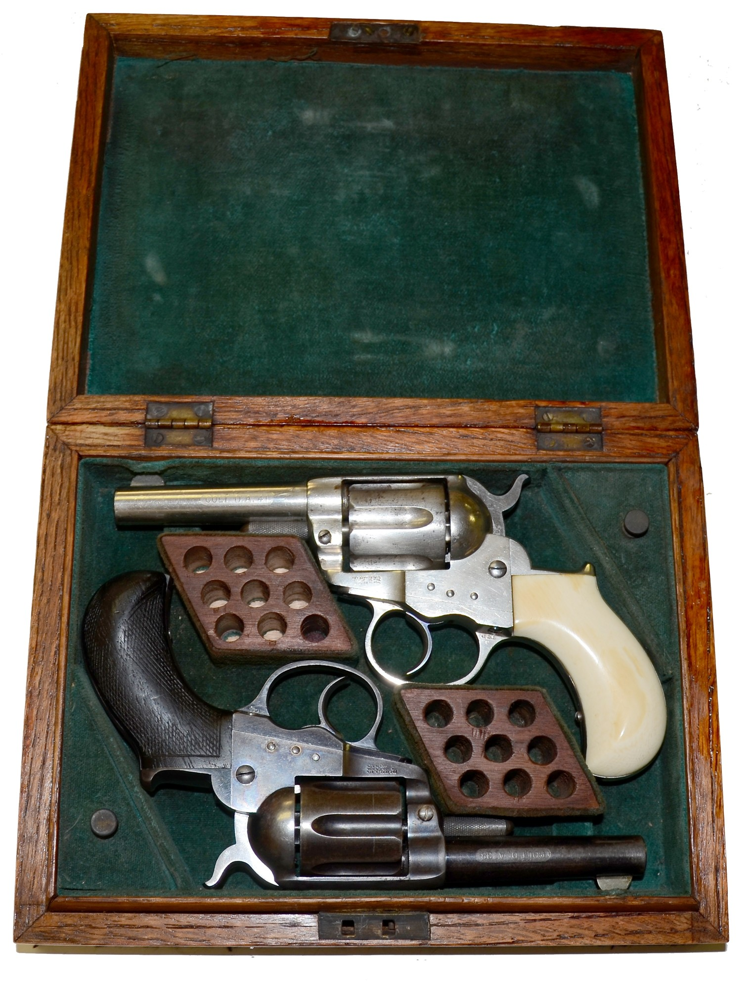 CASED PAIR OF COLT DOUBLE ACTION M1877 REVOLVERS — Horse Soldier