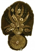 NICELY DONE 19TH CENTURY EMBROIDERED BURSTING BOMB INSIGNIA