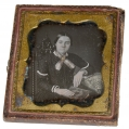 SIXTH PLATE DAGUERREOTYPE OF YOUNG LADY WITH BOOK
