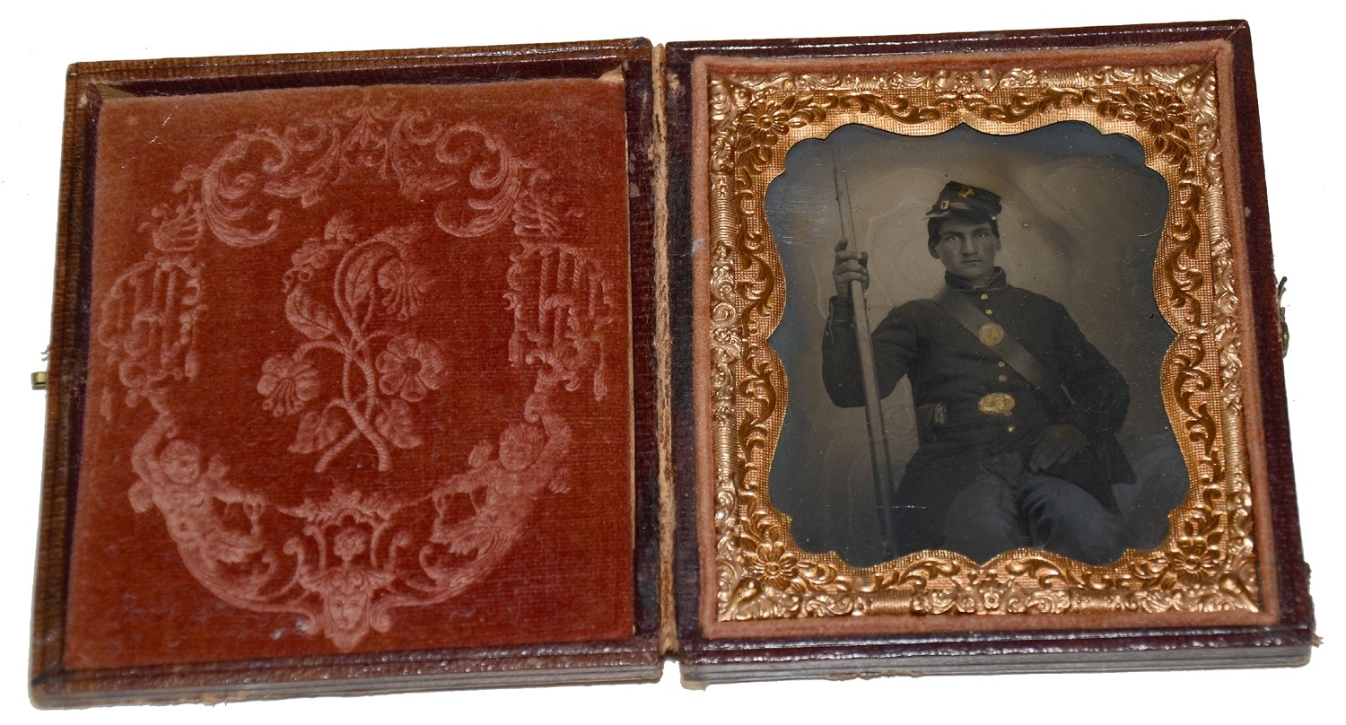 SIXTH PLATE TINTYPE OF SEATED ARMED UNION SOLDIER