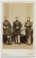 FULL STANDING VIEW OF THREE COMPANY GRADE OFFICERS