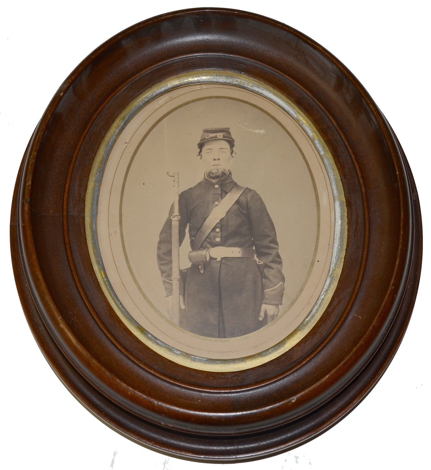 OVAL ALBUMEN PHOTO OF AN ARMED INFANTRY PRIVATE