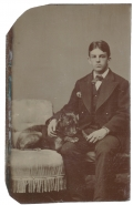 TINTYPE OF A YOUNG MAN WITH A BLACK DOG
