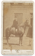 CDV OF YOUNG BOY ON HORSEBACK WITH COMPANION DOG