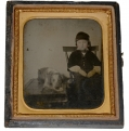 SIXTH PLATE TINTYPE OF YOUNG BOY WITH DOG