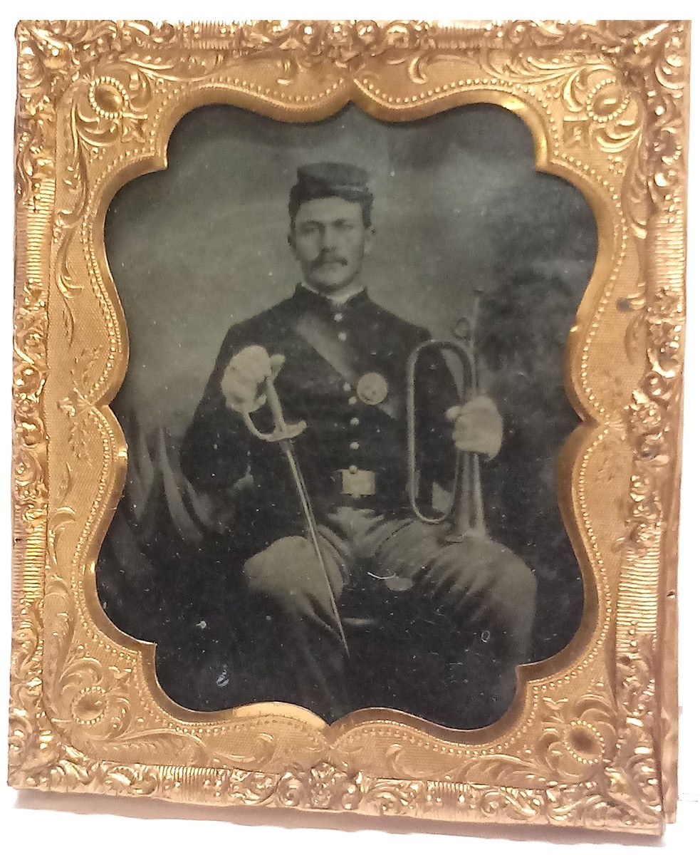 VERY CLEAR TINTYPE OF A NEW YORK SOLDIER WITH SWORD AND BUGLE