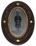 TINTYPE OF AN ARMED UNION 2ND LIEUTENANT IN A THERMOPLASTIC FRAME