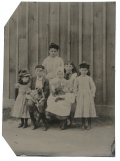 TINTYPE OF A GROUP OF CHILDREN AND THEIR PETS
