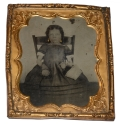 SIXTH-PLATE TINTYPE OF A YOUNG GIRL HOLDING A LITTLE BASKET