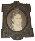 "THERMOPLASTIC ""MEDALLION"" FRAME WITH IMAGE OF YOUNG LADY"