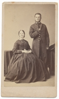 CDV OF BESPECTACLED SOLDIER AND WIFE